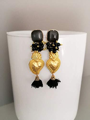 Spedizione gratuita orecchini a grappolo con cuori sacri dorati e nappine nere