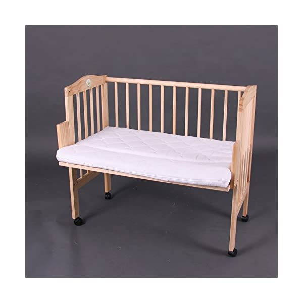 Bed side cot all inclusive 90x40cm, pink stripes Bambino World Main features:3 possible uses:Bed side cot (3 sides closed),Cot bed (4 sides closed),Child sofa;High quality pinewood;Height-adjustable duckboards;Inclusive bedlinen set, canopy and mattress; Bed side cot with large lying space 90 x 40 or 90 x 55cm (if you use the included additional board);Made of high-quality pinewood, clear-varnished with saliva-resistant toy´s paint with a high proportion of wax;Inclusive additional lateral part for use as a cot bed;Height-adjustable duckboards from 17 to 46cm to fit to the height of the parent´s bed; 4 movable castors, 2 with a brake;Overall dimensions 93 x 44/56 x 81cm; Accessories included in our offer:Mattress:High quality mattresses: soft foam polyurethane,Dimensions: 90 x (40+15)cm,Mattress cover: 100% cotton,Quilted on one side with washable fabric,Removable, machine washable at 60°C, 4