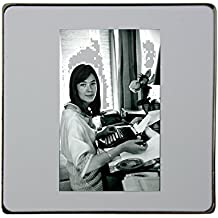 Françoise Hardy typing and looking at camera. metal square fridge magnet