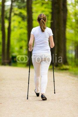 druck-shop24 Wunschmotiv: Nordic walking - middle-age woman working out in city park #123208914 - Bild hinter Acrylglas - 3:2-60 x 40 cm/40 x 60 cm