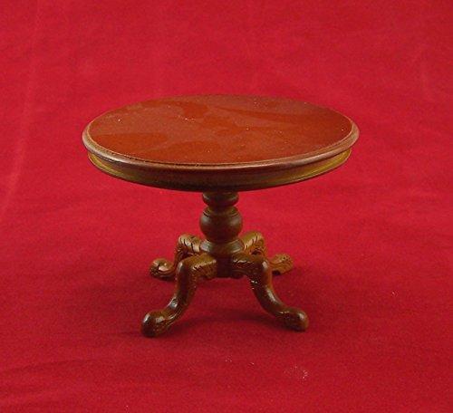 Runder Tisch aus Holz, nussbaumfarben lackiert. Für 1:12 Puppenstuben 10x7 cm.