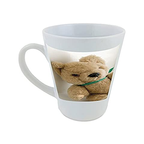Mug with Teddy bear leaning against a wall