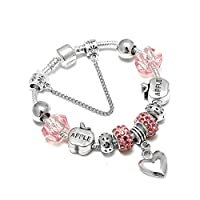 A 925 silver bracelet decorated with beads and pandora elements and heart shaped pendants
