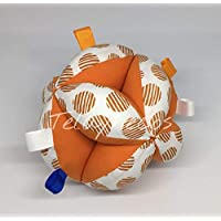 Pelota Montessori topos naranja tiras