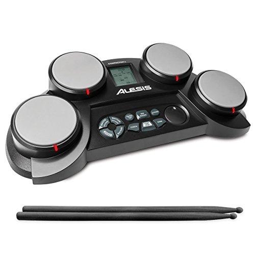 elektronisches schlagzeug fuer anfaenger Alesis Compact Kit 4, E-Drum mit 4 anschlagdynamische Percussion Pads, 70 Schlagzeug und Percussion Sounds, eingebauter Lautsprecher, Kopfhöreranschluss und Drum Sticks