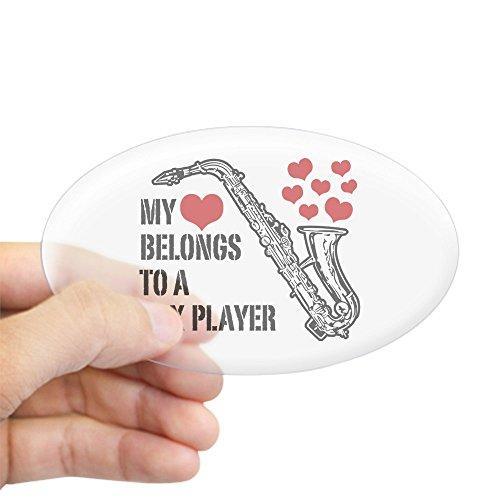 CafePress-My Heart Belongs To A Saxophon Player Aufkleber (Oval)-oval Bumper Sticker KFZ Aufkleber, farblos, Large - 4.5x7.5