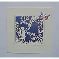 A white silhouette of a fairy in woodland card, fairy card