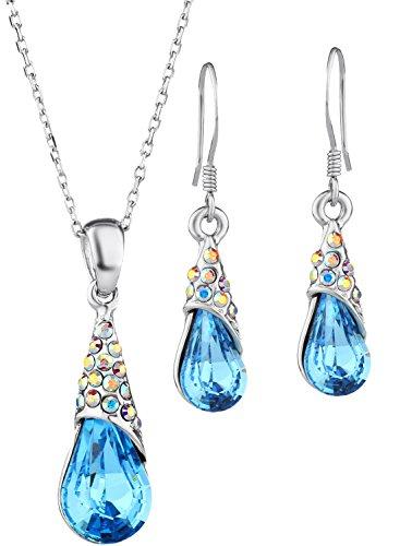 Colgante y Pendientes con cristales Swarovski. Muy elegantes para una niña .