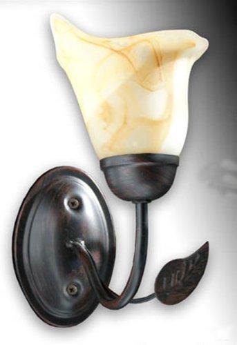 Lampada applique da parete in ferro decorato nero con paralume in vetro; dimensioni cm24*25; attacco E14 tedesco piccolo.