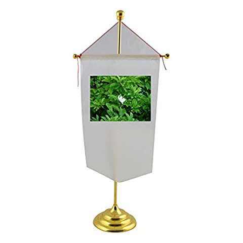 Table flag with Magnolia flowering plant,