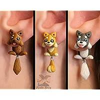 Boucles d'oreilles pour chien, vendues par paire.
