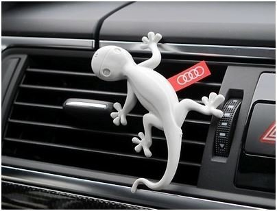 original-audi-fragrance-dispenser-gecko-light-grey-000087009-a-orange-perfume