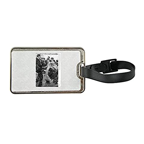 Metal luggage tag with Audrey Hepburn with Mel Ferrer, performing twist.
