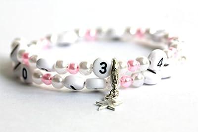 Bracelet d'allaitement de couleur blanc et rose claire en acrylique