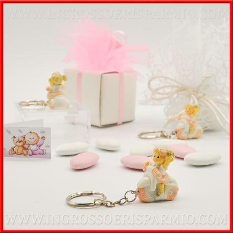 Ciondolo portachiavi in resina colorata a forma di una bimba con treccine bionde che quida una piccola moto con dettagli rosa da femminuccia- bomboniere battesimo,nascita,comunione, primo compleanno (kit 12 pz + confezione)