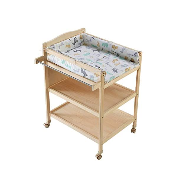 Diaper station Changing table with shelves Solid wood Baby care table Changing table linen Changing unit Nursery organizer for children girls baby baby toddler DSJMUY ★ Table material to change diapers: pine wood. ★ Changing the stable construction of the diaper station: all our products are designed with the safety of your children in mind. ★ Change the pad 2 in 1 Desigh: the changing table can also be used as a massage table for babies.It offers comfort and practicality.It is designed at the appropriate height of the parents to prevent the pains of Mother's back and pains kneel or bend when changing diapers to babies. It has open shelves that add extra security. 1