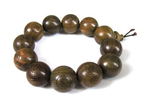 agathe-creation-pulsera-rosario-budista-cuentas-de-madera-de-sandalo-diametro-19-mm-perlas-sculptees