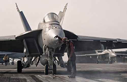 giovanni-colla-stocktrek-images-an-f-18e-super-hornet-is-guided-into-catapult-aboard-uss-george-hw-b