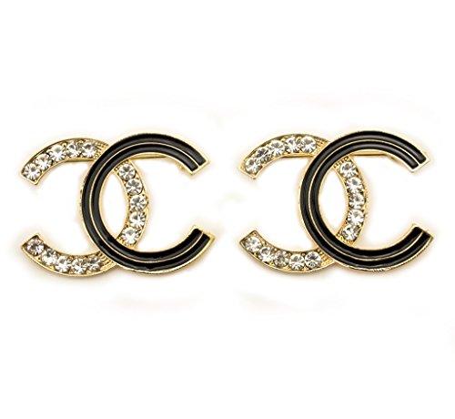 spilla-hand-xne003-elegante-spilla-con-cristalli-bianchi-diamante-e-smalto-nero-in-un-ambiente-frame