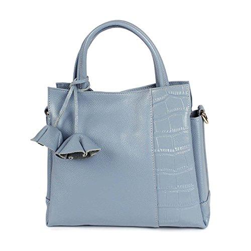 La borsa di cuoio della donna parte del sacchetto di spalla della borsa di stile della zona delle nappe di pietra Red