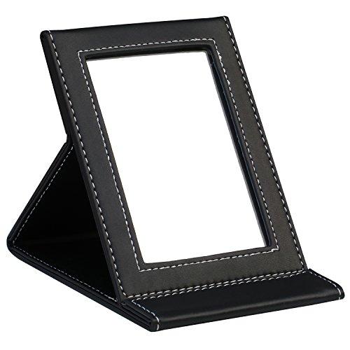 Trixes specchio pieghevole con cornice in finta pelle nera.