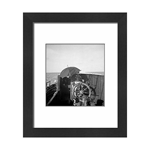 Price comparison product image Media Storehouse Framed 10x8 Print of Quintin Riley at helm under umbrella (11697723)
