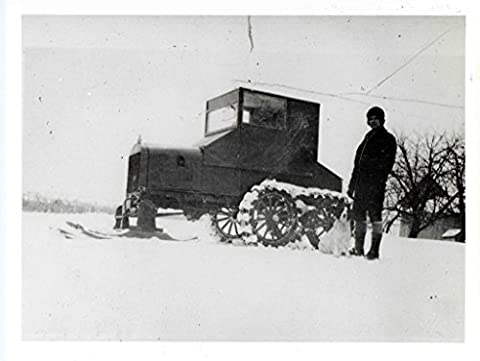"""POSTER rural letter carrier modified Model T Ford c 1926 Object number A 2009 54 Medium paper photo emulsion An rural letter carrier poses next to a Model T Ford vehicle a snowmobile attachment vehicle fitted a kit advertised as """"Mailman's Special"""" from manufacturer Farm Specialty Manufacturing Company New Holstein Wisconsin It included skis that replaced front tires"""