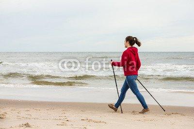 druck-shop24 Wunschmotiv: Nordic walking - young woman working out on beach #101389652 - Bild auf Alu-Dibond - 3:2-60 x 40 cm/40 x 60 cm
