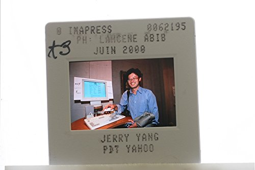 slides-photo-of-close-up-of-former-ceo-of-yahoo-inc-jerry-yang-working-with-his-computer