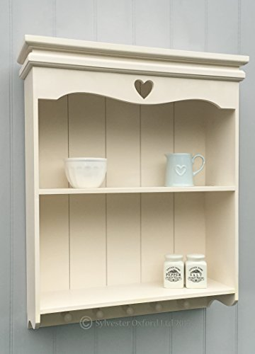 shelving-unit-with-carved-heart-in-ivory