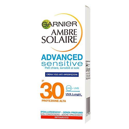 Garnier ambre solaire crema solare viso anti-imperfezioni e anti-lucidità advanced sensitive, protezione solare alta ip30, 50 ml