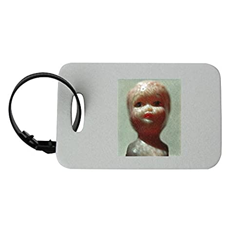 Luggage tag with A doll