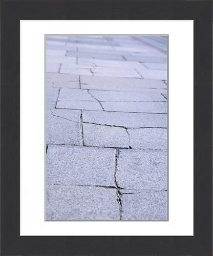 framed-print-of-cracked-slabs-on-pavement-requiring-repair