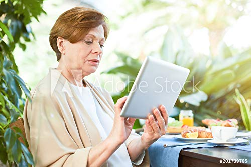 Rest Touchpad (Wunschmotiv: Pretty woman with touchpad searching for video in the net while having rest after breakfast in her home garden #201739785 - Bild als Klebe-Folie - 3:2 - 60 x 40 cm / 40 x 60 cm)