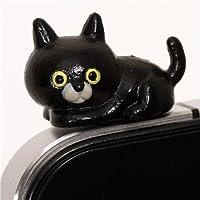Protector de entrada de auriculares en móvil gato negro