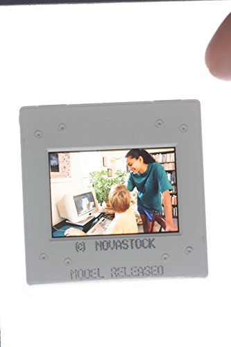 slides-photo-of-a-woman-and-a-boy-watching-from-a-computer