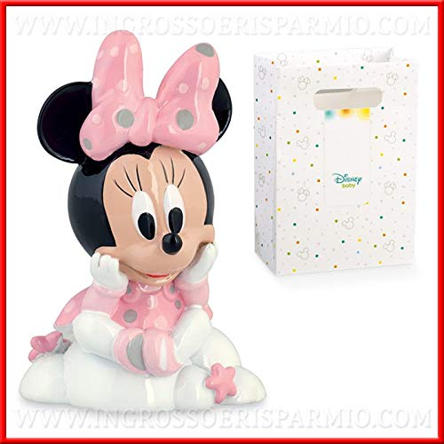 estatuilla con forma de Minnie/Minnie Mouse, firmada Walt Disney, representada asiento sobre una nube blanca, con la cabeza sobre entre las manos, de resina, con vestido rosa y un gran lazo rosa lunares sobre el jefe. Esta figura también es perfecta ...