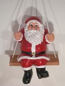 Figur Weihnachtsmann H 40 cm auf Schaukel sitzend Dekofigur zum Aufhängen aus Kunstharz
