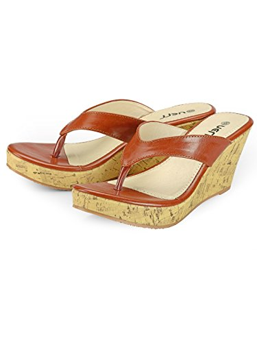 Nell Women Tan Solid Wedges ( Size-39)  available at amazon for Rs.345