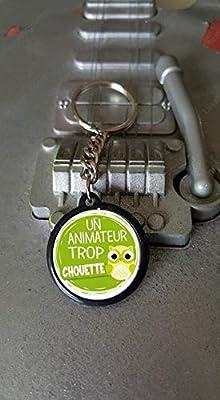 Porte clés 25 mm Un Animateur Trop Chouette
