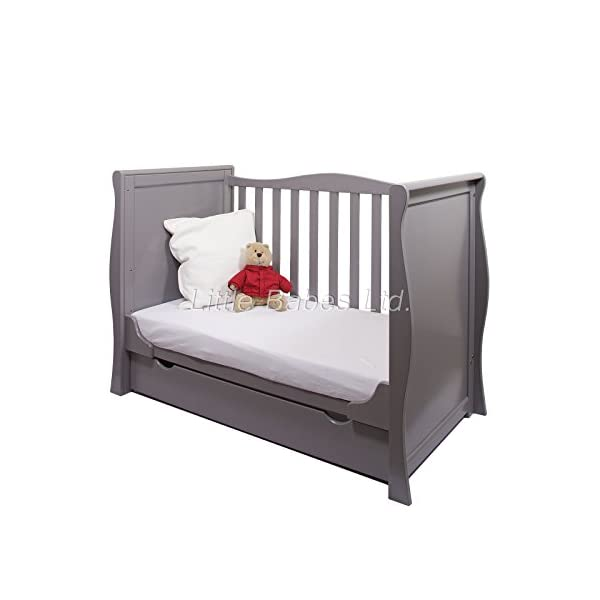New Pinewood Grey Sleigh Mini COT Bed & Drawer ONLY LITTLE BABES LTD GREY SLEIGH MINI COT BED WITH DRAWER ONLY, NO MATTRESS INCLUDED *COMPLIES WITH CURRENT BRITISH & EUROPEAN STANDARDS BS EN 716-1: & 2:2008 + A1:2013* MINI COT BED FEATURES: -quality pine wood, -converts to junior bed and sofa, - 3 position mattress base, - teething rail on one side only, -one curved side, -strong base, -underneath drawer on runners included. 3