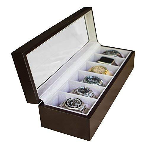 Exhíbalo. Disfrute del brillo de las piedras, el brillo de metal y el cuero texturizado. Esta caja de relojes de madera maciza conectará sus tesoros de horología con los espacios relajantes de su vida. Usted podrá admirar hasta seis hermosos relojes ...