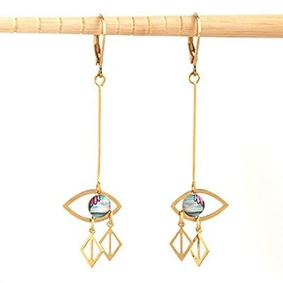 Boucles d'oreilles design regard. Doré à l'Or fin idée cadeau noël, originale.