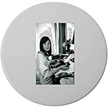Ceramic round coaster with Françoise Hardy typing and looking at camera.