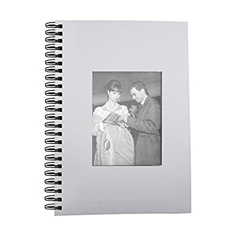 Notebook with Elsa Martinelli standing with a man looking at