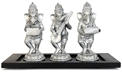 TiedRibbons® Lord Shri Ganesha / Ganapati Playing Musical Instruments Dholak, Harmonium , Sitar Idol Statue Showpiece Set of 3 with Wooden Base  available at amazon for Rs.1299