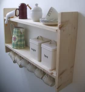 shelves with hooks for cups Mug hooks, also known as cup hooks, provide extra storage space for coffee and tea cups, freeing up valuable cupboard space in the process plot your hook layout in advance by equally spacing the hooks under the cabinet using small pieces of masking tape as guides for drilling.