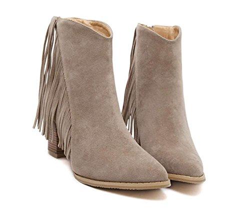 La signora della molla ha grossi stivali con tacco alto scarpe stivali Martin Khaki