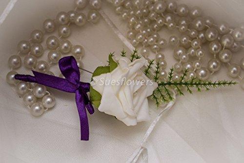 wedding-flowers-single-buttonholes-in-ivory-and-cadburys-purple