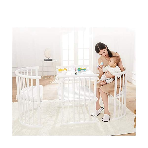 ZXM Solid Wood Multifunction Baby Cot European Style Cot Bed Toddler Bed Splicing Bed Round Bed Children's Bed Suitable for 1-8 Year Old boy and Girl ZXM ★ Multi-functional crib not only allows the baby to have a better sleep experience, but also cultivates the baby's independent consciousness and exercises the baby's hand and foot coordination ability. It is the best gift for the baby. ★ The crib is made of environmentally friendly pine wood, which is durable and not easy to crack. Its carrying capacity exceeds 80KG. Healthy and environmentally friendly paint, it is harmless to the baby, is the best choice for mothers. ★ The three pedestal positions of the crib are suitable for the baby's growth stage, improve visibility and ventilation in all directions, and adjust according to the baby's body and age to make the space bigger and more comfortable. 4
